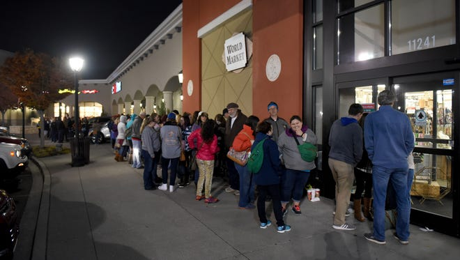 World Market shoppers lined up in the dark for the Black Friday deals in Turkey Creek Friday, Nov. 25, 2016.