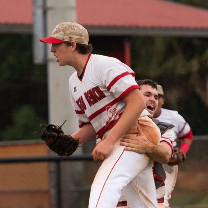 Vero Beach winning pitcher Hunter Cooley (left) is