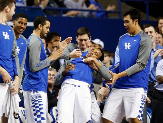 Kentucky's E.J. Floreal is the victim of Jamal Murray's