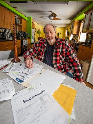 Newark resident Doug Haring received unusual surcharges and price spikes on his electric bills when he was a customer of Peoples Power and Gas.