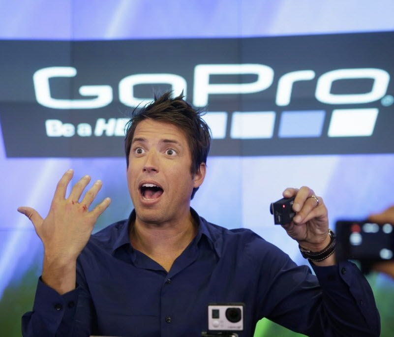 This June 26, 2014, file photo shows GoPro's CEO Nick Woodman being filmed by multiple GoPro cameras as he celebrates his company's IPO at the Nasdaq MarketSite in New York.