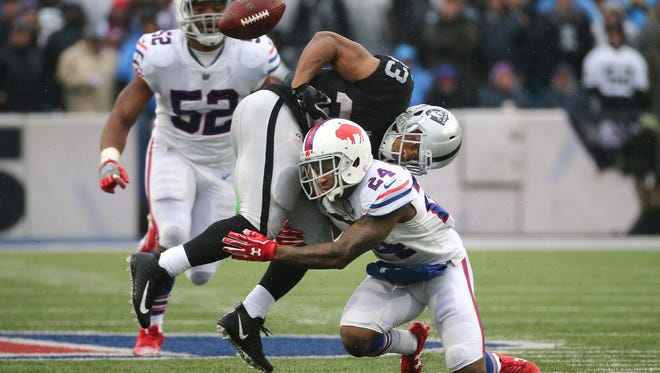 Buffalo's Leonard Johnson's (24) tackles Oakland running back DeAndre Washington to cause a fumble that was picked up by Buffalo's Matt Milano for a touchdown late in the second quarter in last Sunday's Bills' win in Orchard Park.