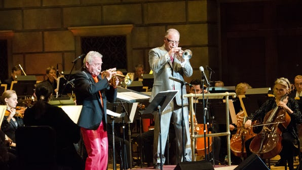 Doc Severinsen and Jeff Tyzik blow the high notes at Tyzik's 20th anniversary celebration in April 2014.