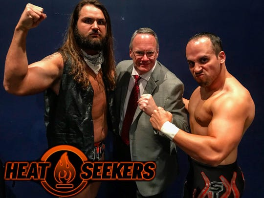 Matt Sigmon, right, is one half of the professional wrestling tag team known as The Heat Seekers. He and his brother, Jonathan Ward, are opening an Anytime Fitness franchise in Hardin Valley.