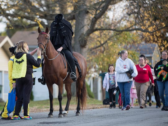 Megan Smith rides as the headless horseman through local neighborhoods for Halloween in 2016. Smith has been riding through the Cowing Park neighborhood for 16 years after wanting to try something different for the holiday.