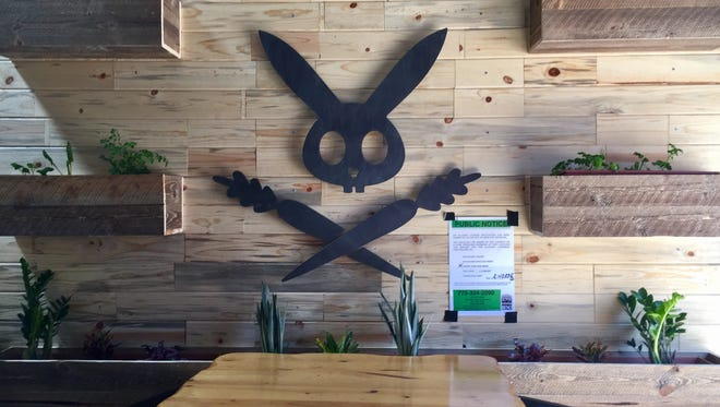 The DeLuxe's rabbit logo adorns one wall of the restaurant's new West Street Market digs. The restaurant serves some of the city's best healthful food, showing a light touch and a way with flavors.