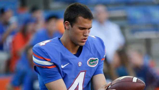 Florida punter Kyle Christy warms up prior to a game against Missouri in Gainesville, Fla., Saturday, Oct. 18, 2014.