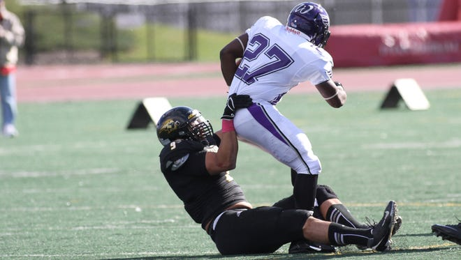 Titans Dexter Charles brings down Whitewater's Jordan Ratliffe in Whitewaters 17-14 win over Oshkosh on Oct. 26, 2013.