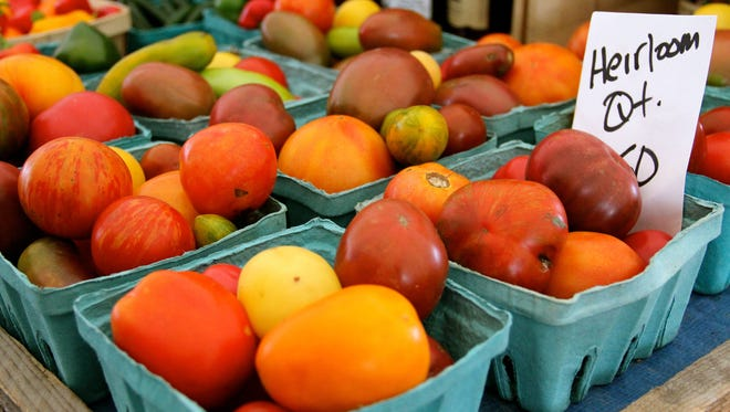 The recent heat wave may have delayed the ripening of home-grown tomatoes.