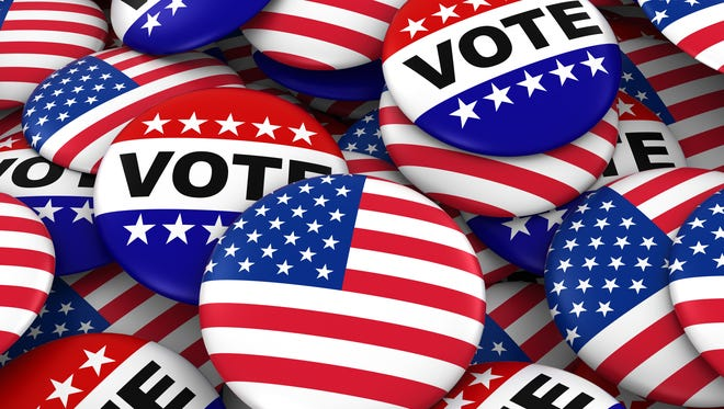 United States flag and vote badges