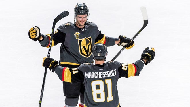 Vegas Golden Knights defenseman Colin Miller (6) and forward Jonathan Marchessault (81) react after scoring on the Florida Panthers during the first period at T-Mobile Arena.