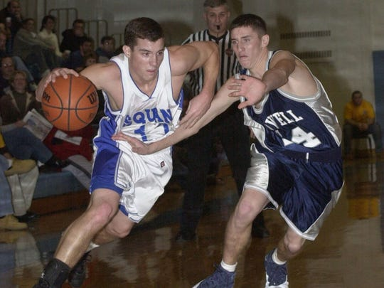 Manasquan's Tom  White drives to the basket against Howell.
