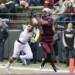 Montana wide receiver Jamaal Jones (6) catches a touchdown pass earlier this season. The Griz play host to South Dakota State on Saturday. (AP Photo/Patrick Record, File)