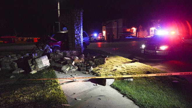 Des Moines police investigate a fatal crash Wednesday night at SW 9th Street and Bundy Avenue on the city's south side.