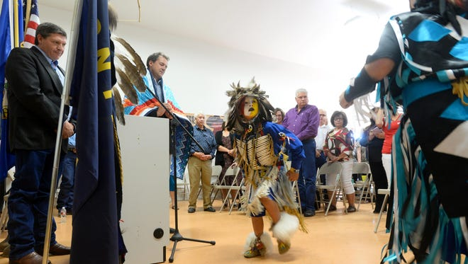 Cordiero, center, and Dametries Houle dance to an honor song for Gov. Steve Bullock during the Little Shell Tribe's recognition event Thursday at the The Little Shell Cultural Center. At the event, Bullock recognized the Little Shell Tribe Language Program and grant recipients of the Indian Equity Fund.