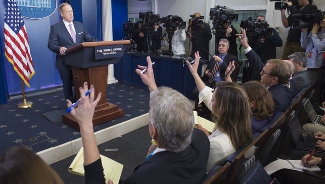 White House Press Secretary Sean Spicer holds the first daily press briefing of the Trump administration in the Brady Press Briefing Room at the White House in Washington, DC, January 23, 2017. / AFP / SAUL LOEB        (Photo credit should read SAUL LOEB/AFP/Getty Images)
