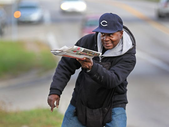 """Willie Holley, 57, has been selling papers from a corner for The Enquirer since 1995. For the past several years he's been stationed on Ridge Rd at the Norwood Lateral. Horns honk to signal the driver wants a paper or just to say Hi. Willie has a lot of friends. Recently, Alysun Ogilby, a member of Crossroads Church, decided to make a difference in Willie's life. She started a crowd funding page called """"Bless the Paper Man"""". What started with $5.00 is now over $2,000.00."""