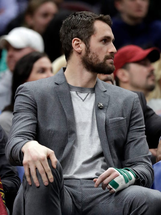 Cleveland Cavaliers' Kevin Love watches from the bench in the first half of an NBA basketball game against the Houston Rockets, Saturday, Feb. 3, 2018, in Cleveland. (AP Photo/Tony Dejak)
