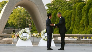 President Barack Obama shakes hands with Japanese Prime Minister Shinzo Abe after laying a wreath in front of the cenotaph.