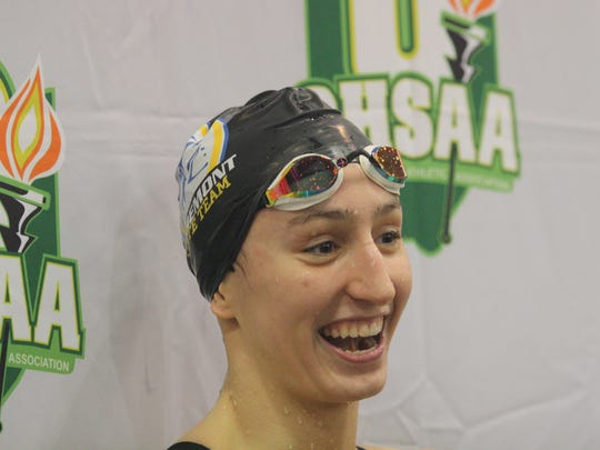 Cora Dupre, of Mariemont, gets interviewed after her second state championship swim of the night, this time in the 100 freestyle at the Division II state meet on Friday, Feb. 23, 2018, at C.T. Branin Natatorium in Canton, Ohio.