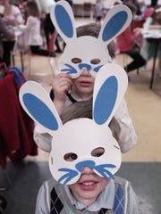 Drew Phelan, 3, and brother William Phelan, 5, wear their bunny masks made at the bunny brunch craft workshop in this hometownlife.com file photo.