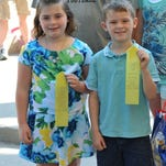 Seven year olds Elizabeth and Racey Craig, of Solon, proudly display their ribbons from the Twins, Triplets and More Contest at the Iowa State Fair on Aug. 13.