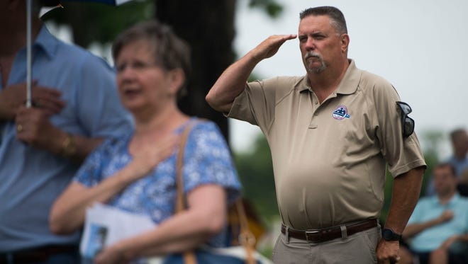 Bill Sachse, of Chatanooga National Cemetery salutes during a Memorial Day ceremony at Knoxville National Cemetery Monday, May 28, 2018.