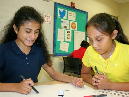 GEMS students Johana Chavez and Nathalia Ruiz-Lorenzana