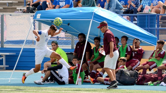 Carlsbad's David Soto tries to keep the ball in play during the first half Saturday against Gadsden.