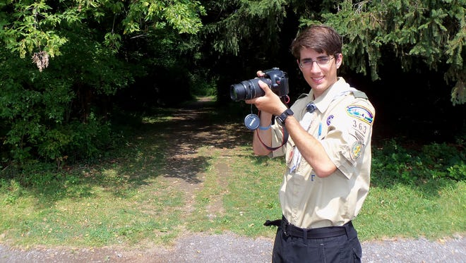 Camera in hand, Joe Fiorica (Troop 363) captures slideshow images of the Webster trails for his Eagle Scout project.