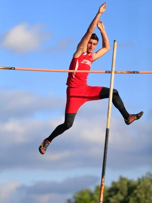 Jeffersonville's Tony Cappola cleared 13 feet 4 inches in the pole vault category Thursday evening at the Track and Field Sectional at Jeff High School. By Matt Stone, The C-J May 21, 2015