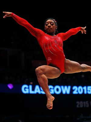Simone Biles of the U.S. performs Oct. 27, 2015, during the floor exercise at the women's team final competition at the World Artistic Gymnastics championships at the SSE Hydro Arena in Glasgow, Scotland.