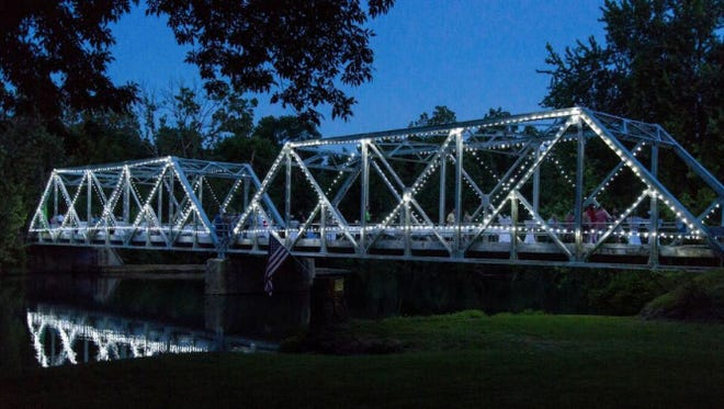 The Finley River bridge in Ozark is aglow with lights during the first Sunset Soiree.