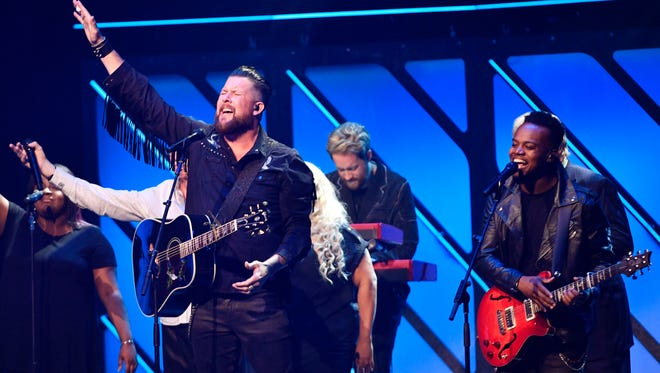 """Zach Williams performs """"Chain Breaker""""with Travis Greene, Koryn Hawthorne, and the Oak Ridge Boys at the 2017 Gospel Music Association Dove Awards at Lipscomb University's Allen ArenaTuesday Oct. 17, 2017, in Nashville, TN"""