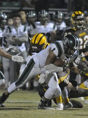 El Diamante's Tyler Youngblood battles for yardage