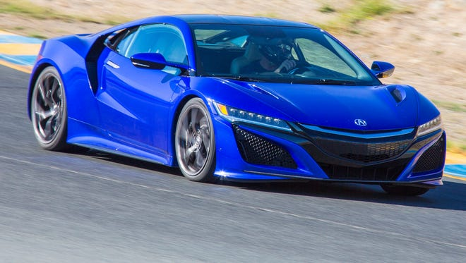 The 2017 Acura NSX takes some hot turns on a racetrack