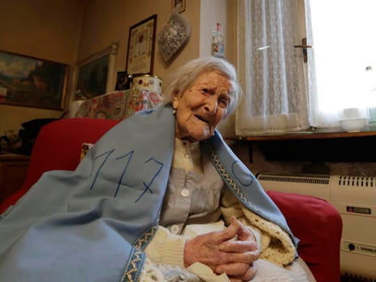 Emma Morano wears a sheet reading 117,  in the day of her birthday in her home in Verbania, Italy, Tuesday, Nov. 29, 2016.  At 117 years of age, Emma is now the oldest person in the world and is believed to be the last surviving person in the world who was born in the 1800s, coming into the world on Nov. 29, 1899.