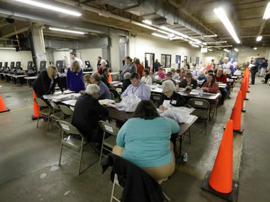 Workers begin a statewide presidential election recount Thursday, Dec. 1, 2016, in Milwaukee. The first candidate-driven statewide recount of a presidential election in 16 years began Thursday in Wisconsin, a state that Donald Trump won by less than a percentage point over Hillary Clinton after polls long predicted a Clinton victory.