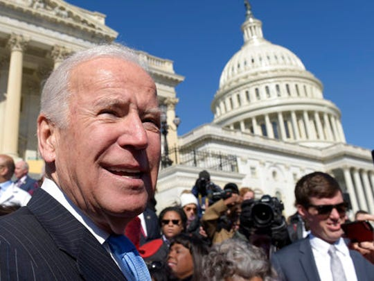 Former Vice President Joe Biden pauses as he greets the crowd on Capitol Hill in Washington, Wednesday, March 22, 2017, following an event marking seven years since former President Barack Obama signed the Affordable Care Act into law.