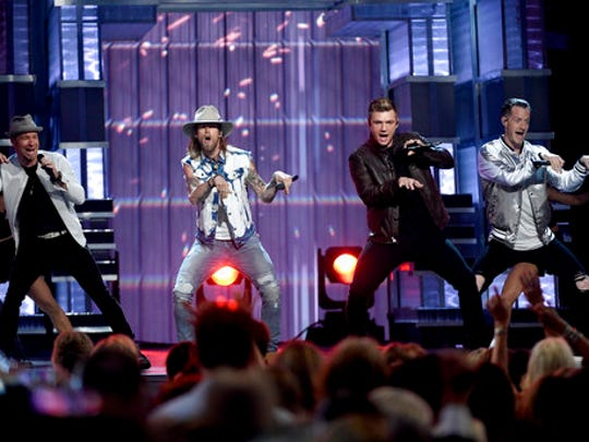 Brian Littrell, left, and Nick Carter, second from right, of Backstreet Boys, and Brian Kelley, second left, and Tyler Hubbard, right, of Florida Georgia Line, perform at the 52nd annual Academy of Country Music Awards at the T-Mobile Arena on Sunday, April 2, 2017, in Las Vegas.