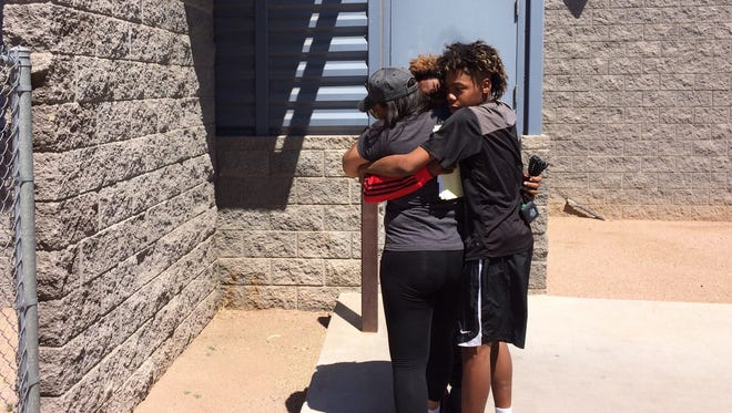 Nathaniel Thomas gets a hug on his release from custody on April 6, 2017, at the Maricopa County Lower Buckeye Jail.