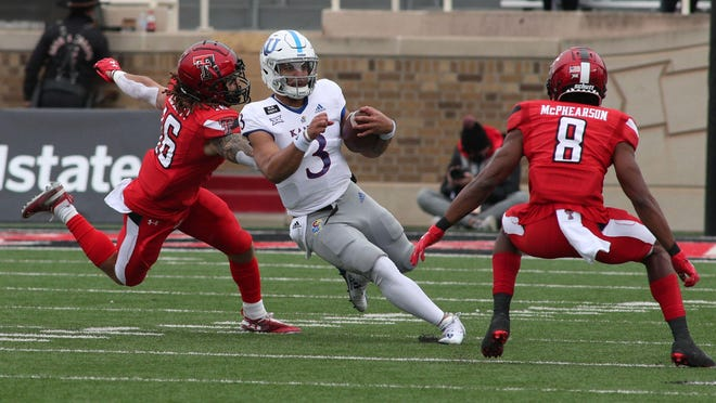 Kansas quarterback Miles Kendrick rushes through the Texas Tech defense in the first half of a game in 2020 at Jones AT&T Stadium in Lubbock, Texas. Kendrick was 17-for-29 passing for 102 yards in the Jayhawks' 16-13 defeat.
