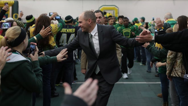 Nov 27, 2015; Eugene, OR, USA; Oregon Ducks head coach Mark Helfrich is greeted by Oregon Ducks fans as he walks through the Moshofsky Center before the game against the Oregon State Beavers at Autzen Stadium. Mandatory Credit: Scott Olmos-USA TODAY Sports