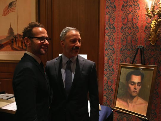 'Will & Grace' creators Max Mutchnick, left, and David Kohan, seen in 2014, donated a show prop to a Smithsonian museum exhibit documenting the history of LGBT Americans.