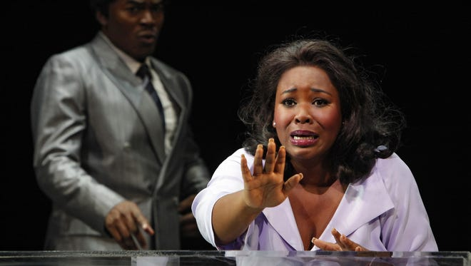 DREAMGIRLS production photo featuring, Moya Angela (Effie), right.  In the background is Chaz Lamar Shepherd (Curtis).
