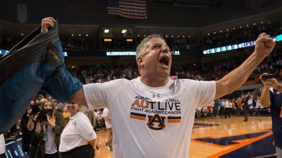 Auburn head coach Bruce Pearl celebrates after the NCAA Basketball game between Auburn and Alabama on Saturday, Jan. 21, 2017, at Auburn Arena in Auburn, Ala. Auburn defeated Alabama 84-64.
