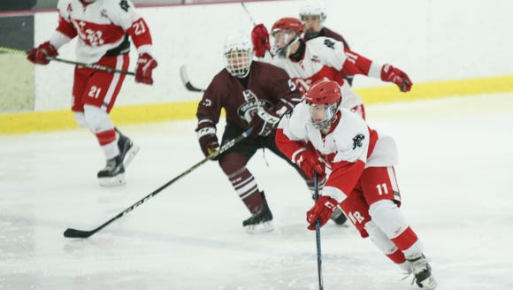 North Rockland's Chris Hilliard (11) works the puck
