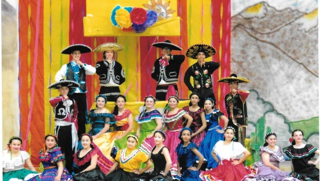 Dancers perform in colorful costumes to the music of Spain, Mexico and New Mexico.