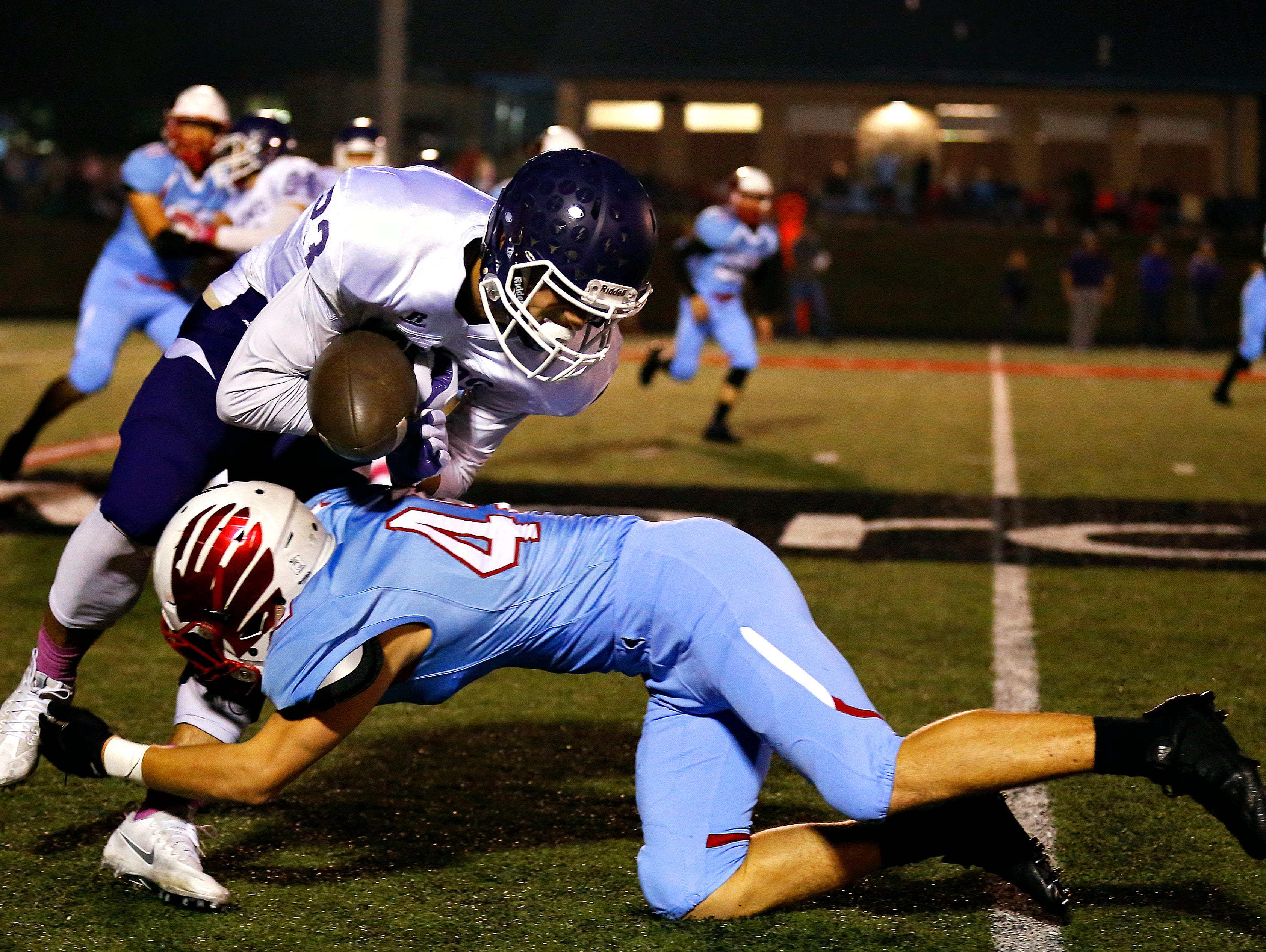 Glendale High School defensive ack Carson Liston (45) jars the ball loose from Lakers kick returner Jacon Hill (23) during first quarter action of the game between Glendale High School and Camdenton High School at Lowe Stadium in Springfield, Mo. on Oct. 14, 2016.