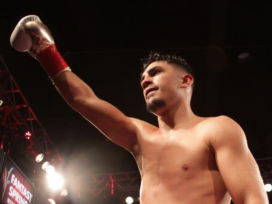 Coachella's Randy Caballero celebrates his victory Ruben Garcia of Mexico City at Fantasy Springs Casino in Indio on February 5, 2016. Caballero won the bout via a TKO.